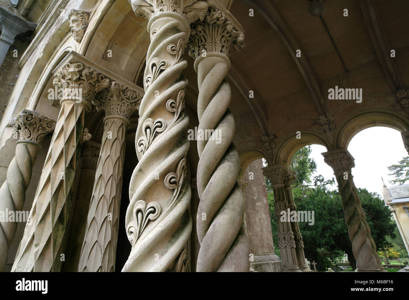 Ornate spiralling columns outside the Church of St Mary and St Nicholas, West Street, Wilton, Hampshire. Stock Photo