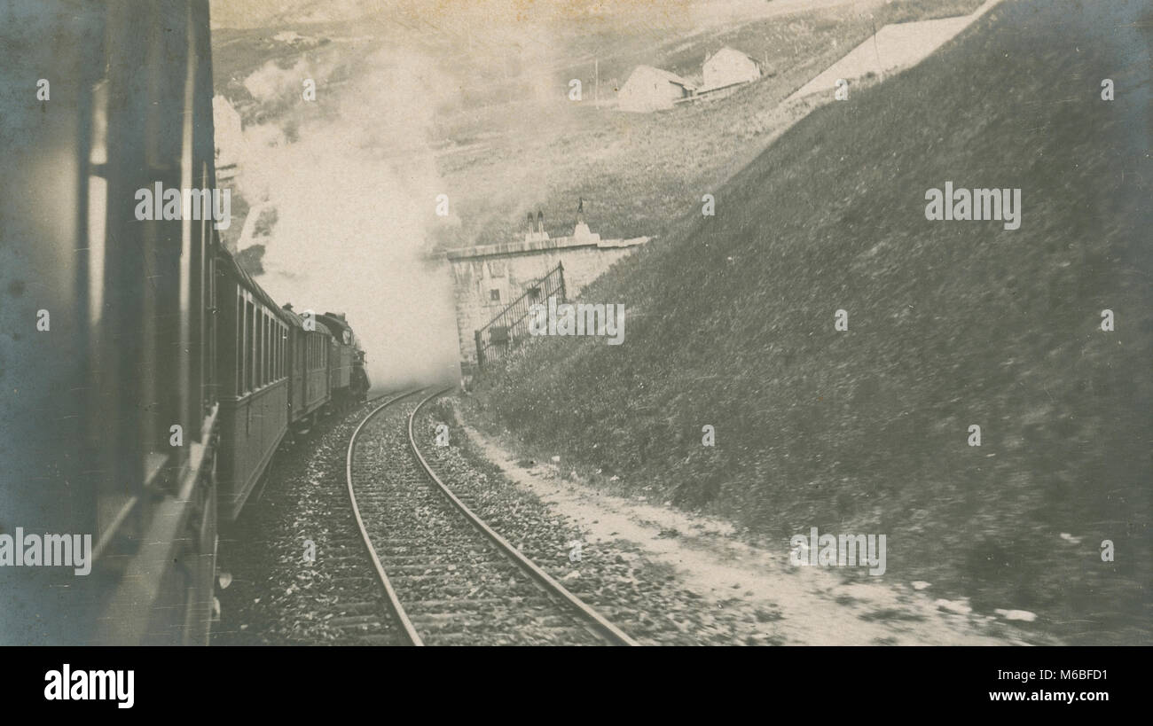 Antique c1900 photograph, steam train entering tunnel. Location unknown, possibly Europe. - Stock Image