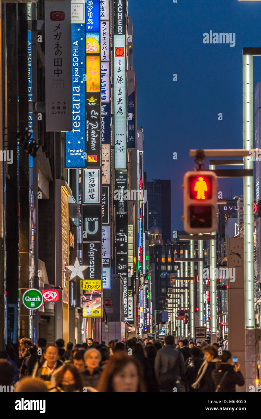 Ginza, Tokyo - December 2017 : Billboards and neon signs in crowded Chuo dori street at Ginza luxurious shopping Stock Photo