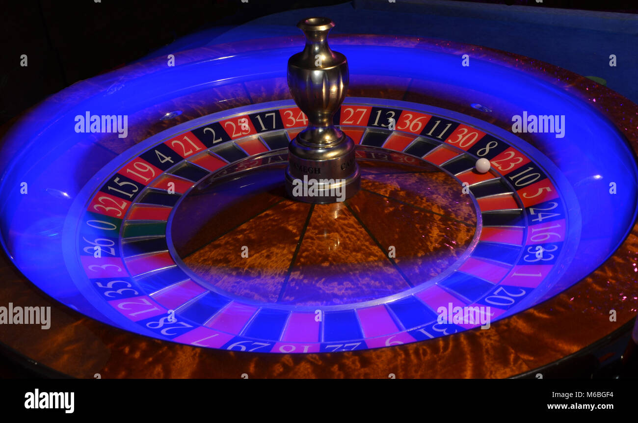 roulette wheel with blue light streak - Stock Image