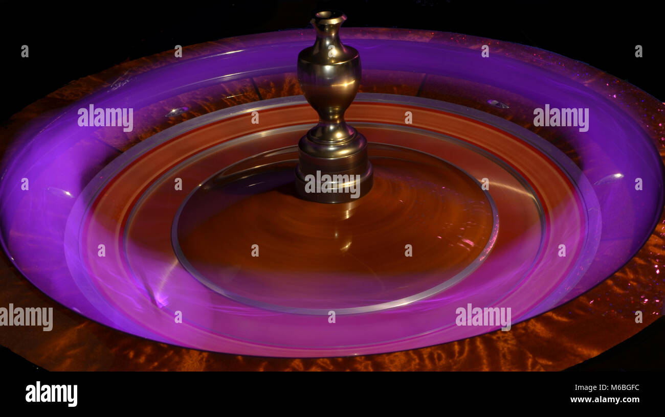 Roulette wheel with pink light streak - Stock Image