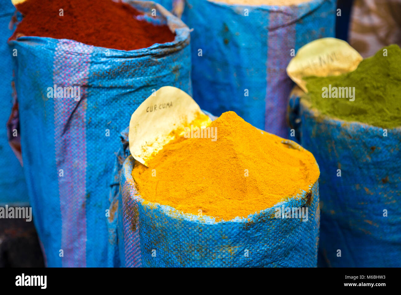 Colourful spices (Curcumin, Henna and Red Paprika) for sale in the souqs (market) in Fes, Morocco - Stock Image