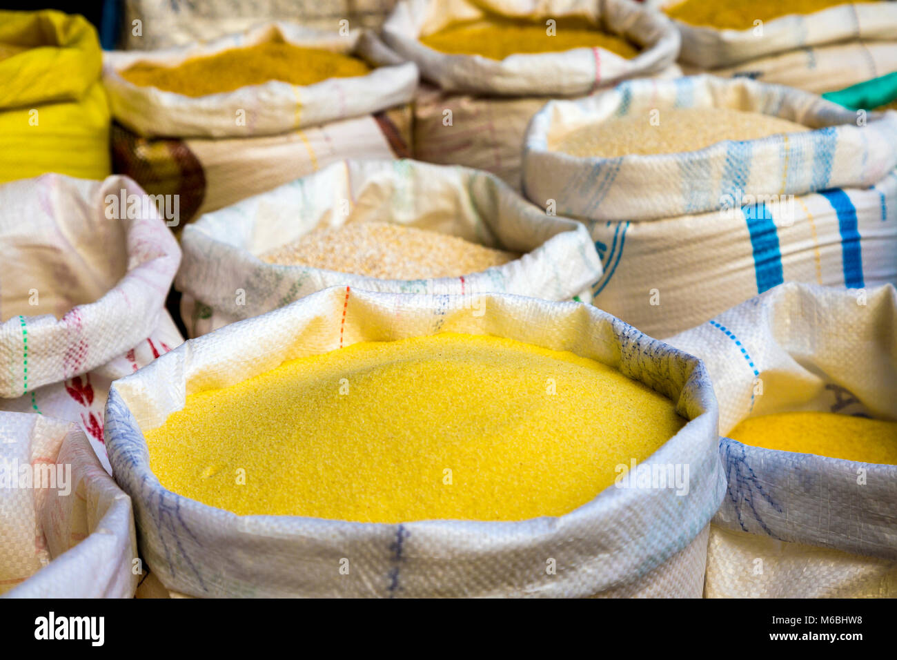 Sacks of grains and flours at a stall in the Old Medina souks in Fes, Morocco - Stock Image