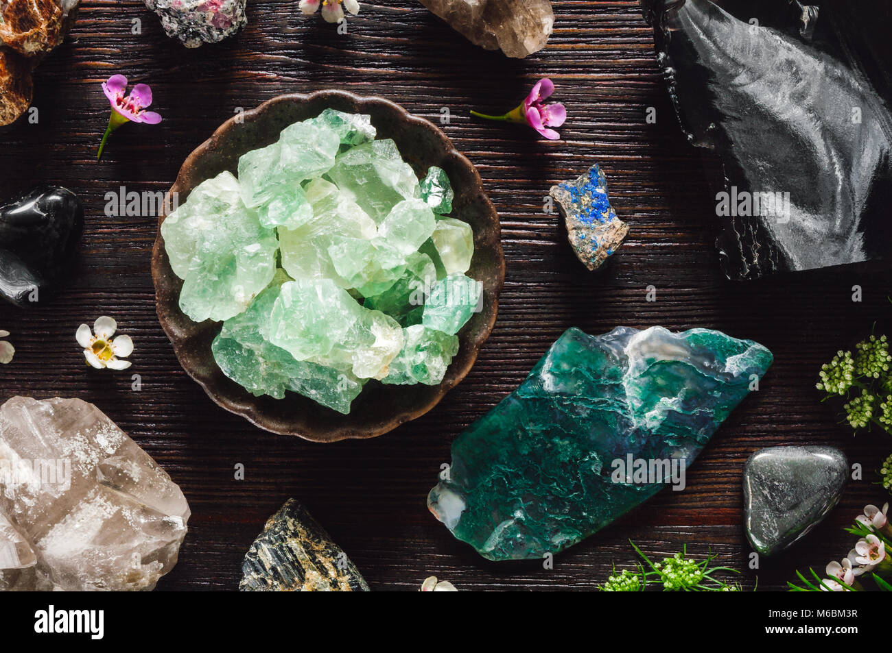 Stones of Capricorn, including Ruby, Hematite, Obsidian, Black Tourmaline, Azurite, Fluorite and Smoky Quartz - Stock Image