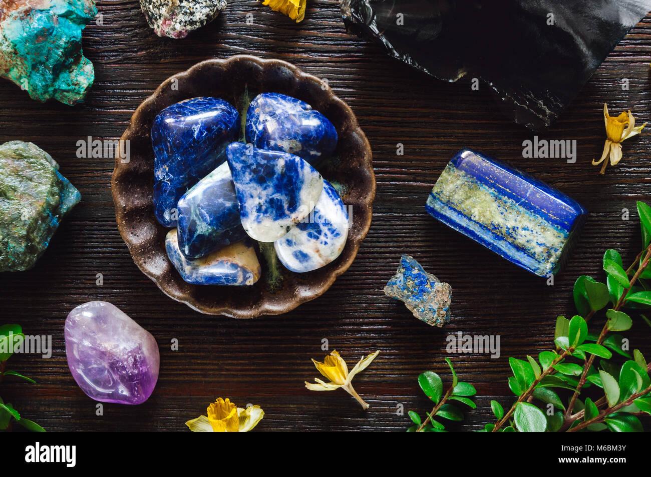 Stones of Sagittarius, including Sodalite, Lapis Lazuli, Labradorite, Turquoise, Azurite, Obsidian, Amethyst and - Stock Image