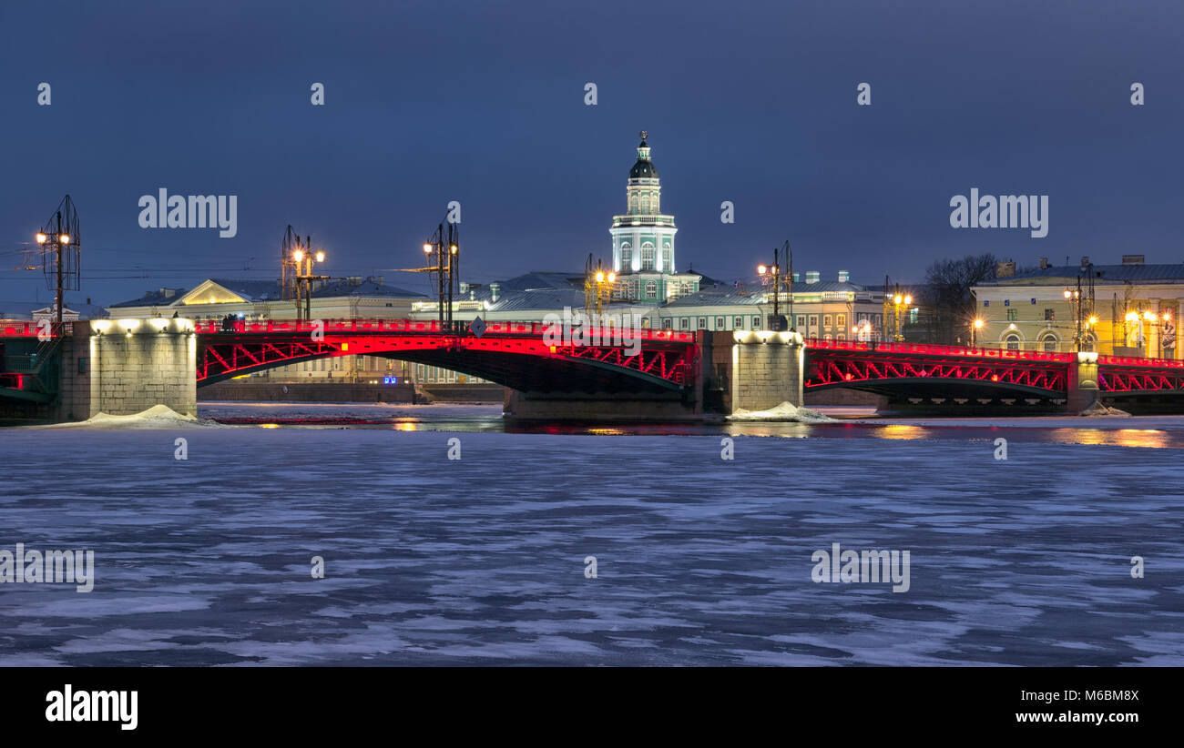 SAINT-PETERSBURG, RUSSIA, FEBRUARY 2, 2017: Night red illumination on The Palace Bridge over The Neva River in honor - Stock Image