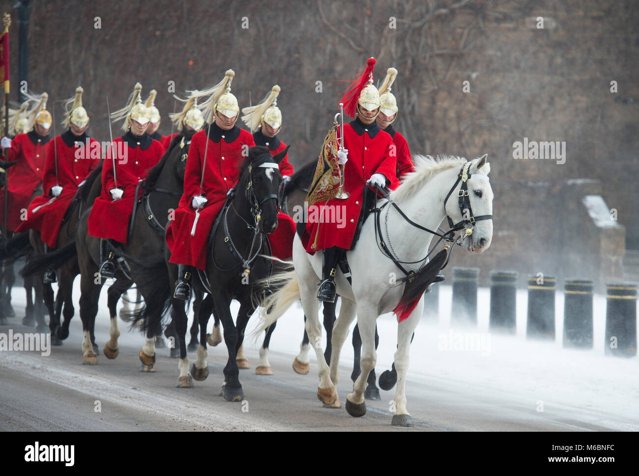 1 March 2018. Life Guards ride through wind blown snow to attend Changing the Guard ceremony at Horse Guards Parade, Stock Photo