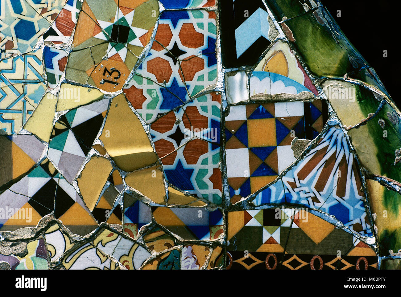 Barcelona, Catalonia, Spain. Park Guell, designed by Antonio Gaudi, 1900-1914. Mosaic on the main terrace, detail. - Stock Image
