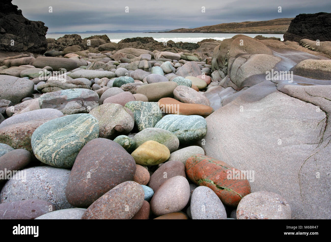 A view of the colorful rocks of Achnahaird Bay on the west coast of Scotland. - Stock Image