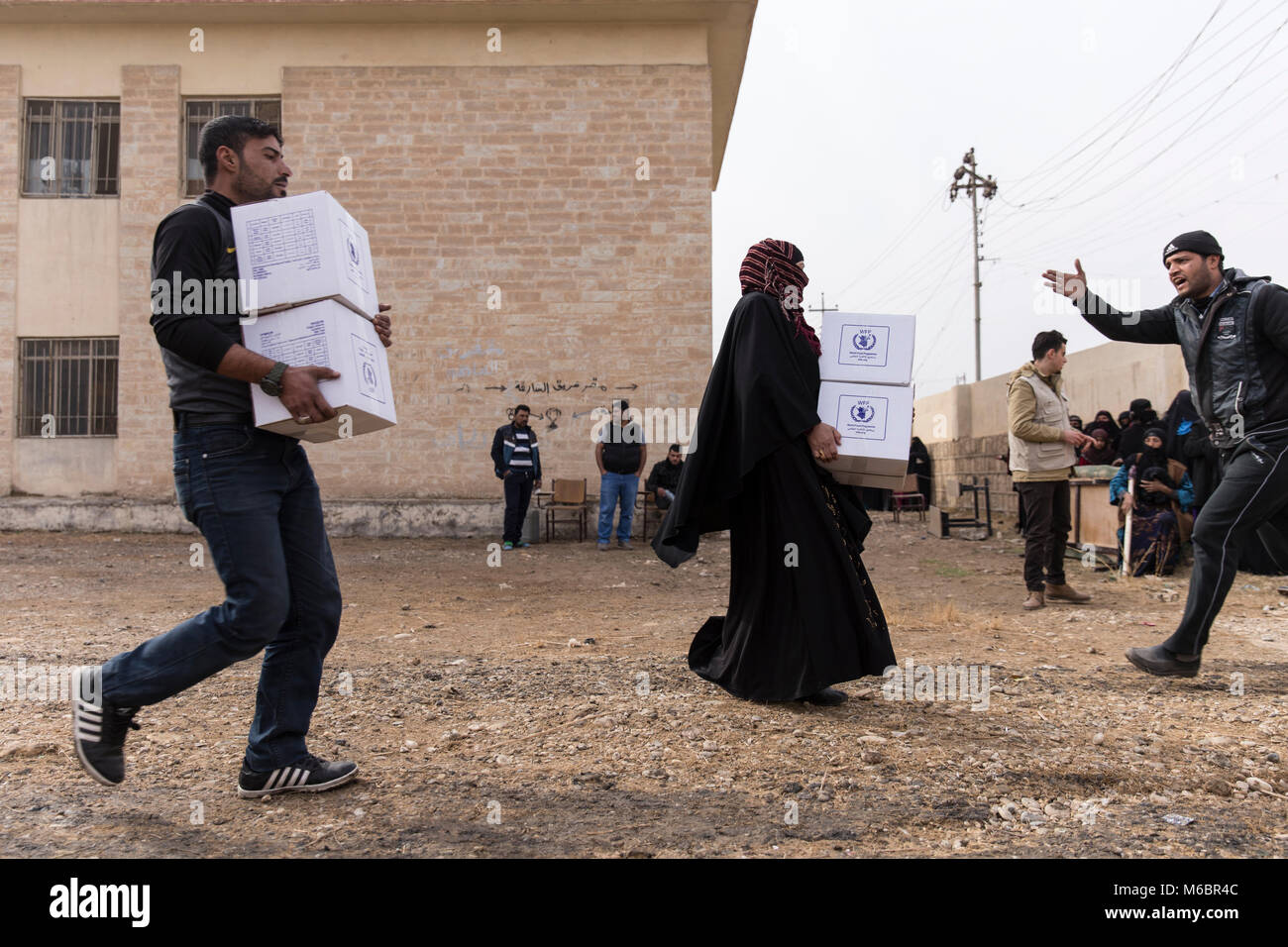 Mosul, Iraq. 8th December 2016 - Mosul locals carry aid to their homes as an operation to remove Daesh is underway - © Ty Faruki Stock Photo