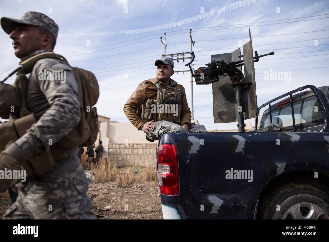 Mosul, Iraq. 8th December 2016 - The Iraqi army and police partner to guard the streets of Mosul while coalition jets thrash through the sky. - © Ty F Stock Photo