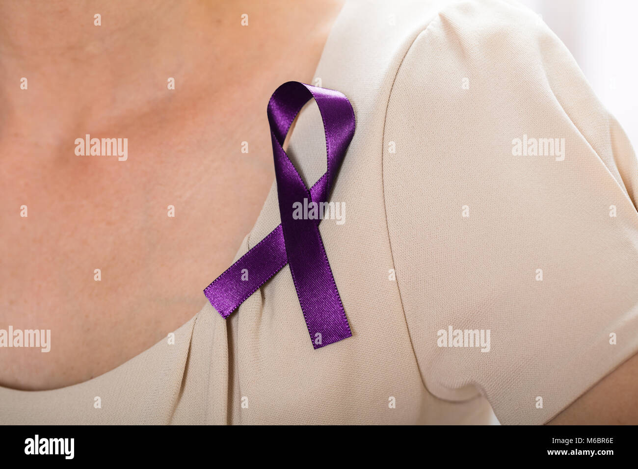 cbc5280edc428 Close-up Of A Woman With Violet Ribbon To Support Testicular Cancer  Awareness - Stock
