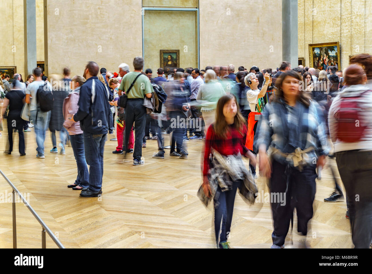 PARIS - MAY 16: Unidentified huge group of tourist taking photos to Mona Lisa at the Louvre Museum on May 16 2015 - Stock Image