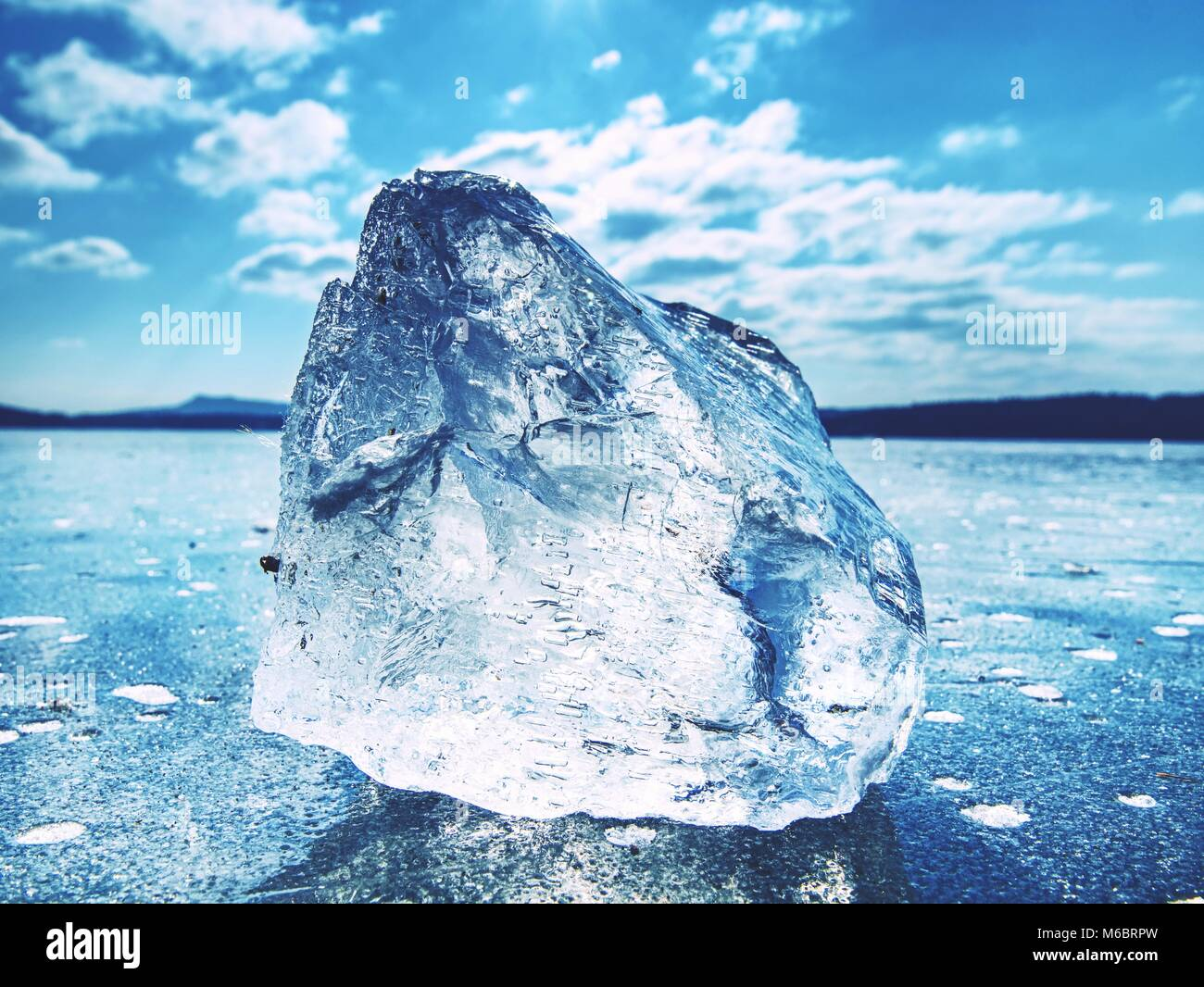 Shining broken ice. It beautifully shimmers the sun's rays, plays light and glare - Stock Image