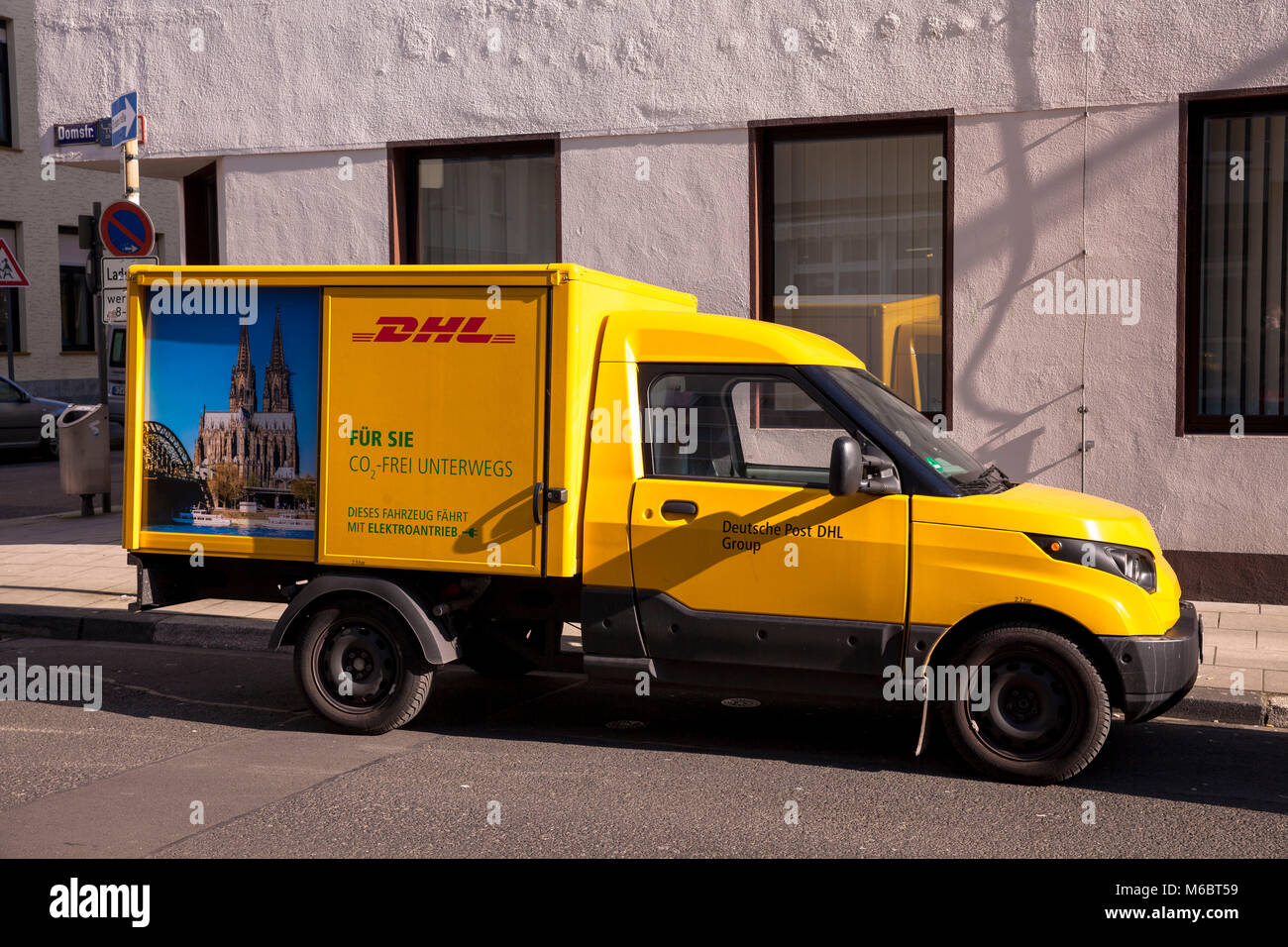 Germany, Cologne, DHL parcel service electric vehicle Streetscooter.  Deutschland, Koeln, DHL- Elektrofahrzeug Streetscooter. Stock Photo