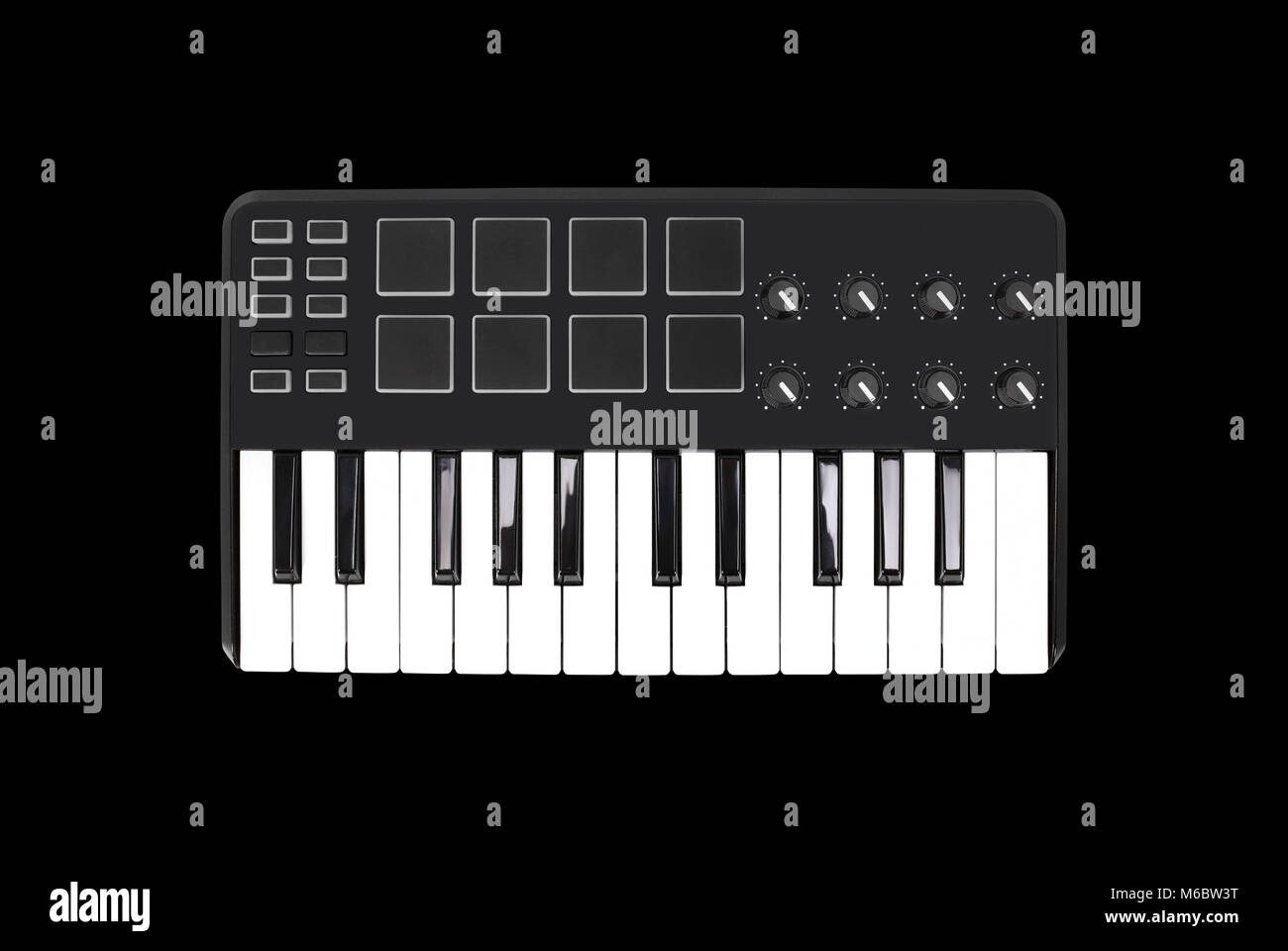 Musical instrument - Sloseup MIDI piano keyboard. It is isolated on a black background - Stock Image