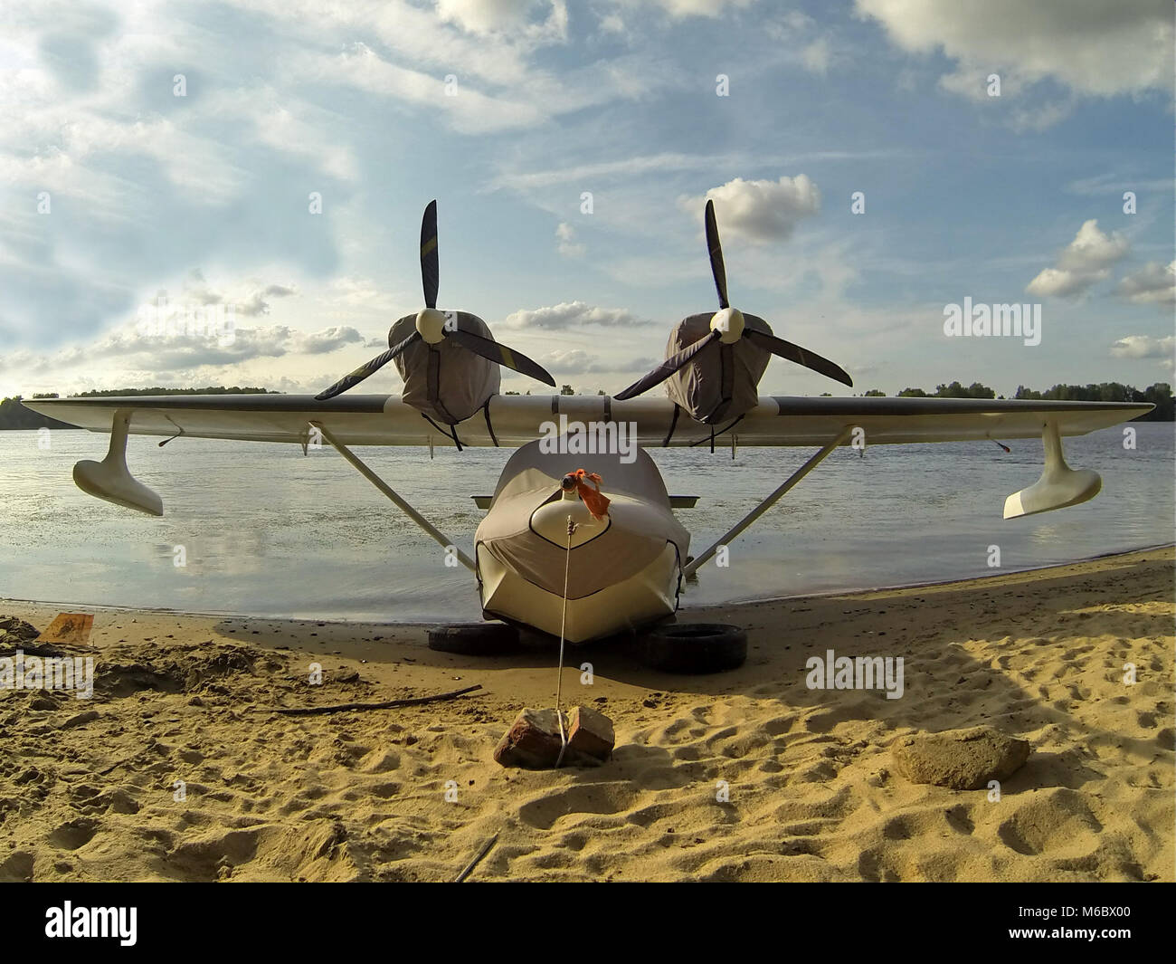 Flying boat on the beach - Stock Image