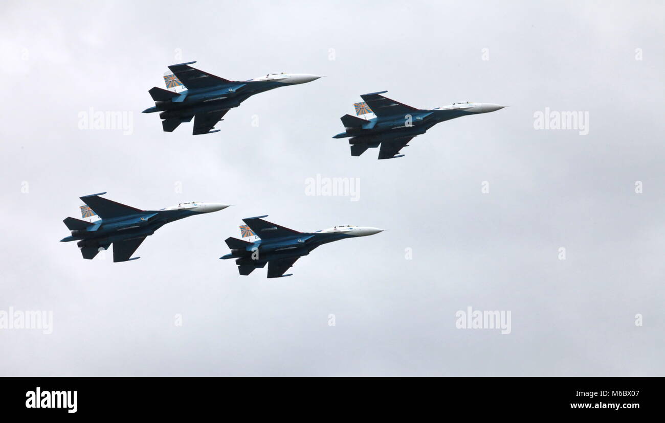 Aerobatic team 'Russian Knights' on the Su-27 performs aerobatics demonstration - Stock Image