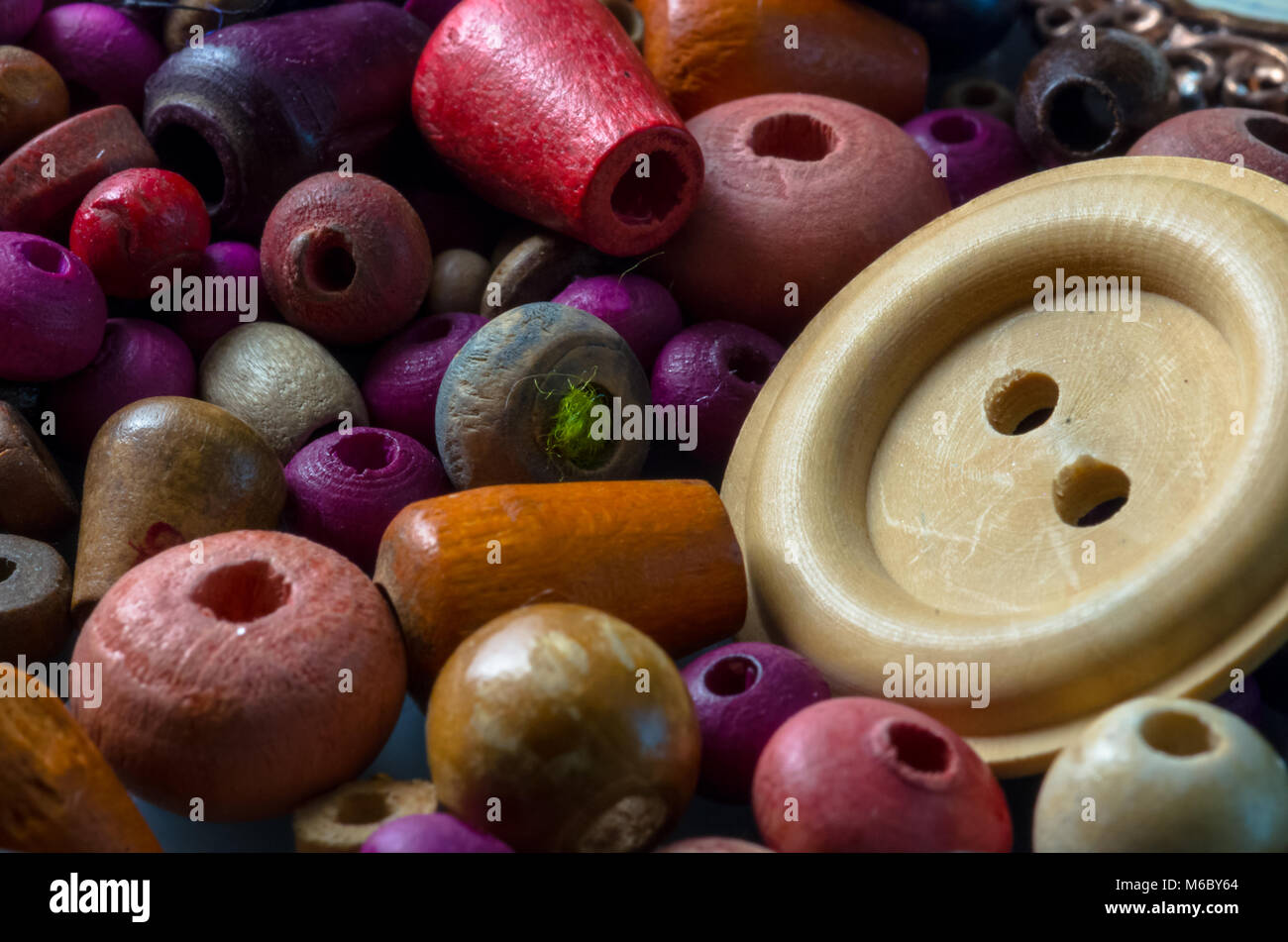 Macro photograph of wooden beads and buttons - Stock Image