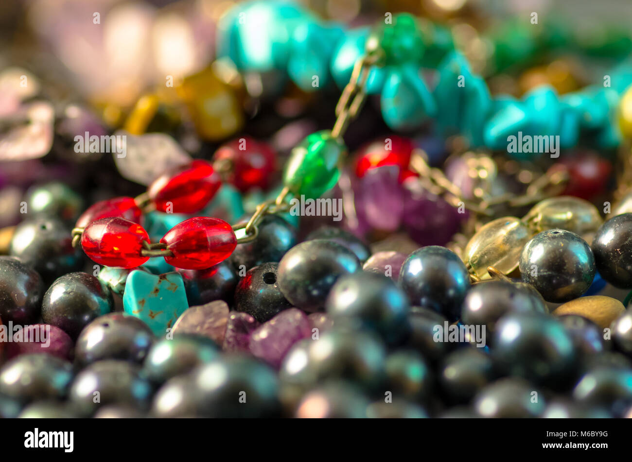 Close up of colorful bracelets and pearls - Stock Image