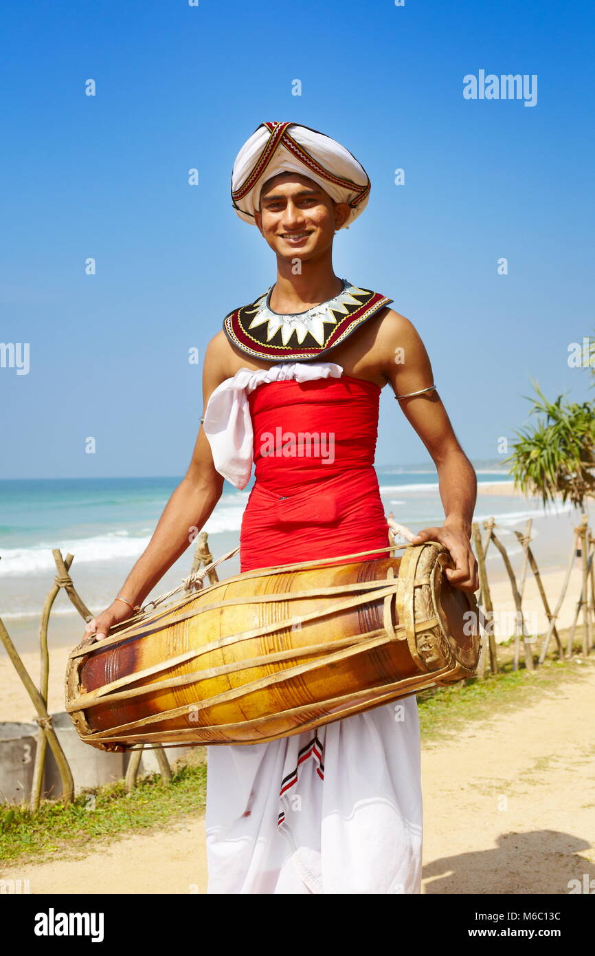 Male local musician dressed in traditional costume, Sri Lanka - Stock Image