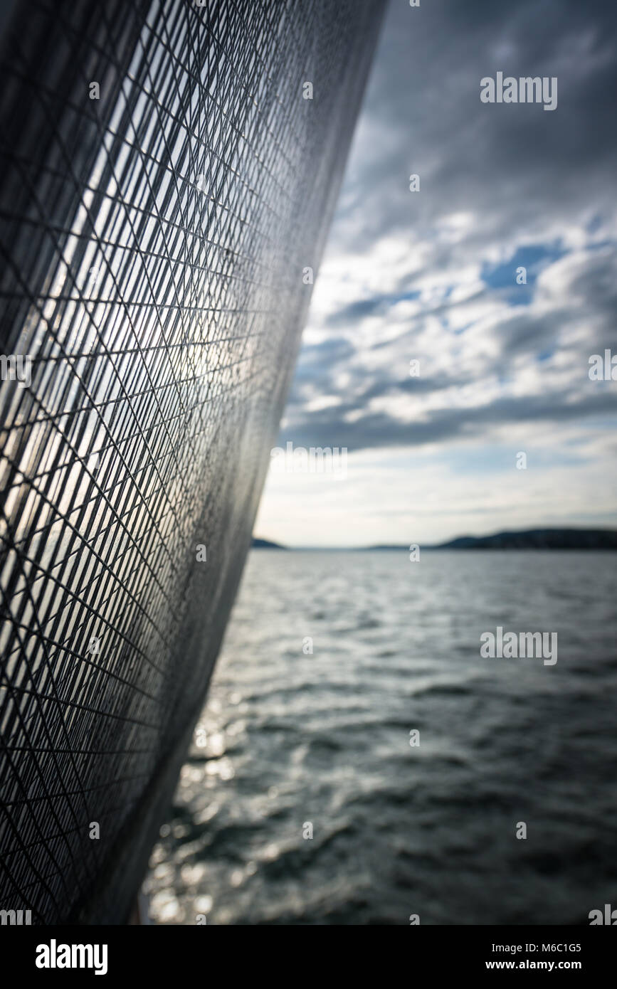 Sails canvas and mast against great cloudy sky - shallow depth of field - Stock Image