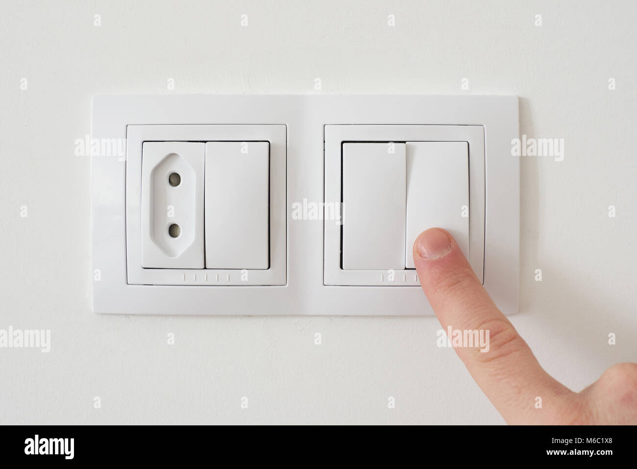 Turn off light switch close up. Electric socket with power plug ...