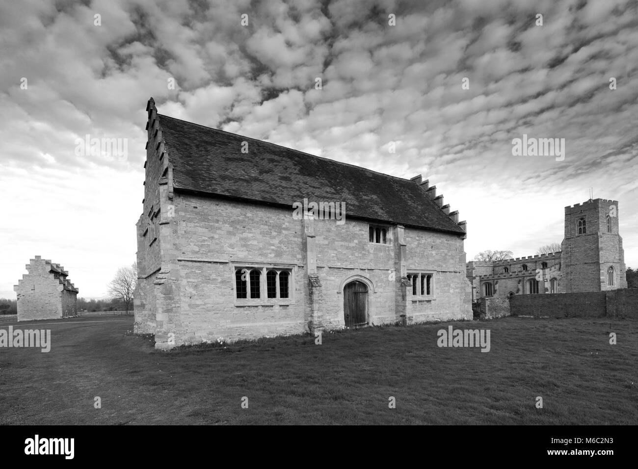 The Willington Dovecote and Stables and St Lawrence church, Willington village, Bedfordshire, England, UK - Stock Image
