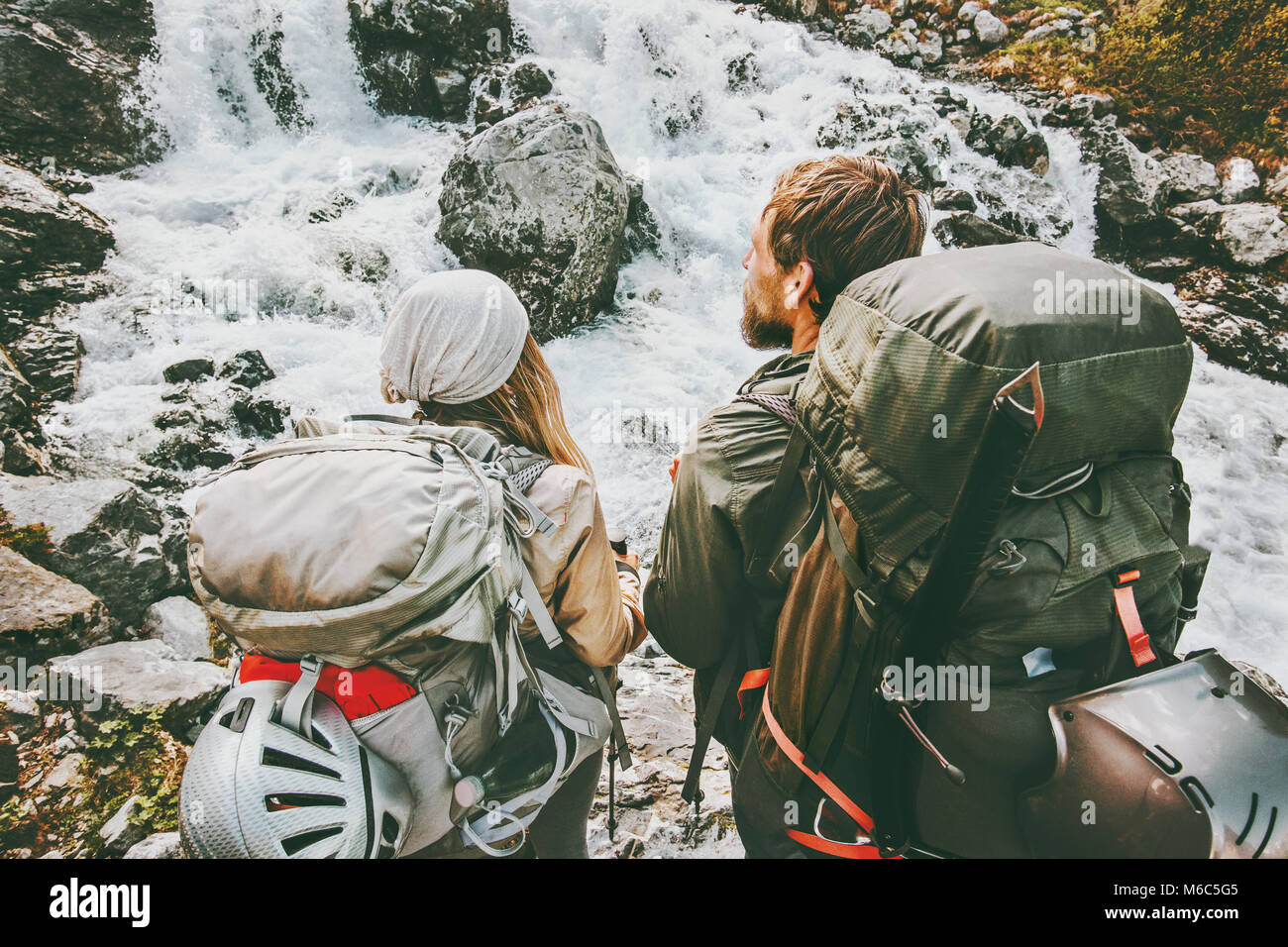 Couple backpackers hiking in mountains together love and Travel adventure Lifestyle wanderlust concept active vacations - Stock Image