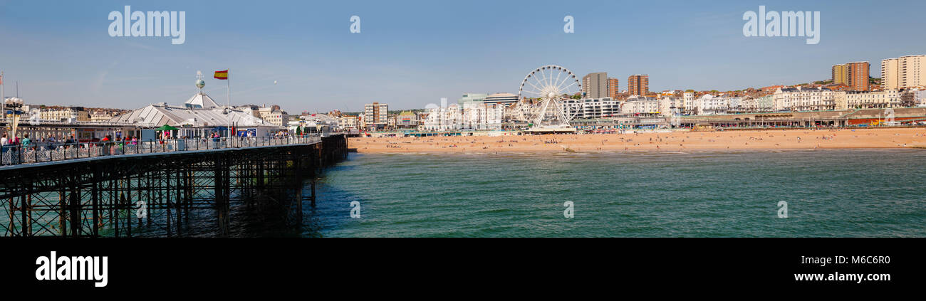 BRIGHTON, UK - JUN 5, 2013: Beachfront panoramic view with the Ferris Wheel promenade and shingle beach pictured - Stock Image