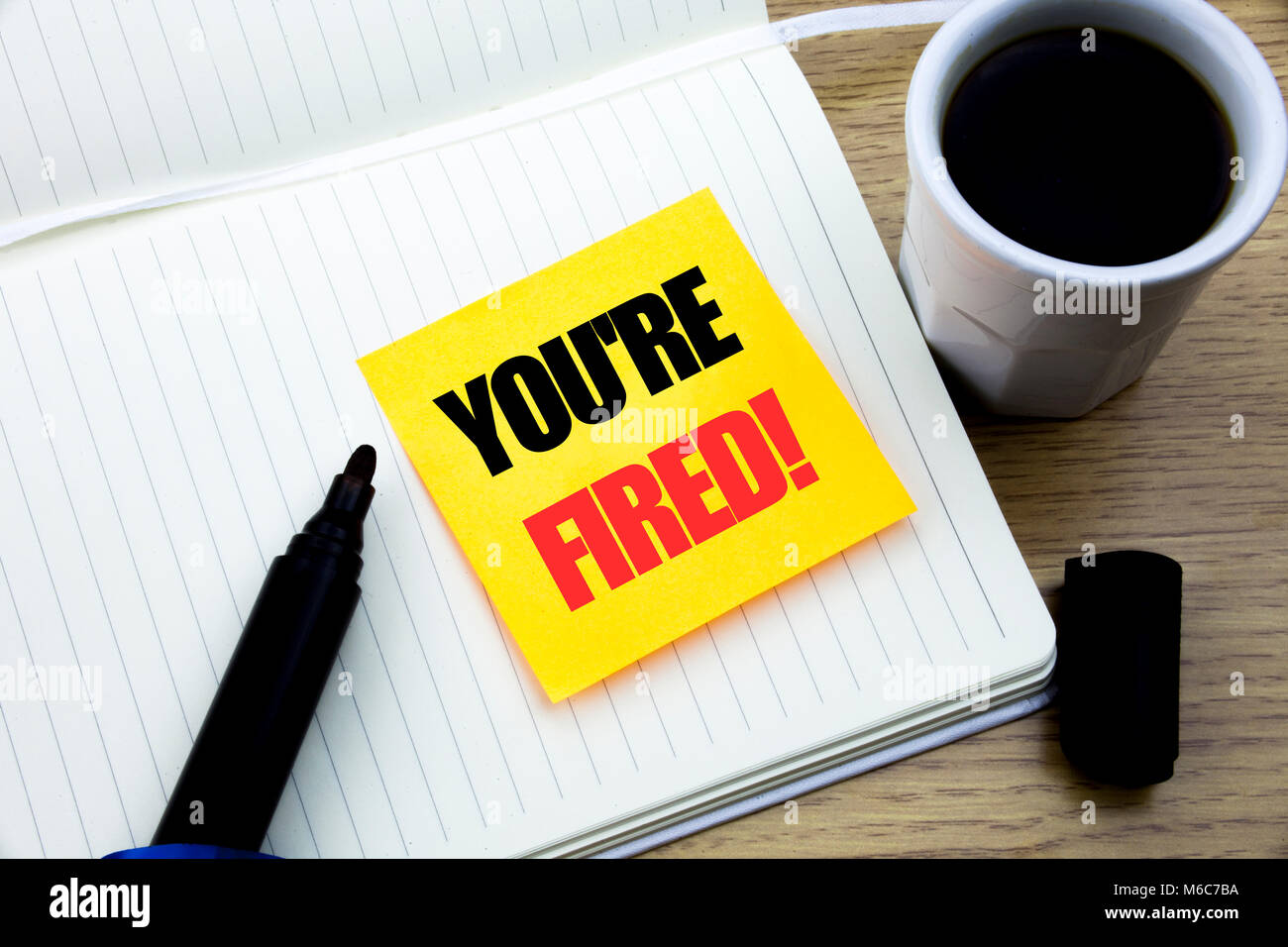 Hand writing text caption inspiration showing You Are Fired. Business concept for Unemployed or Discharge written - Stock Image