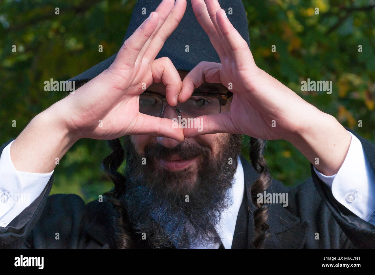 What is Judaism and how real Jewish Orthodox should dress and look like. Outdoor sunny portrait of a young smiling - Stock Image