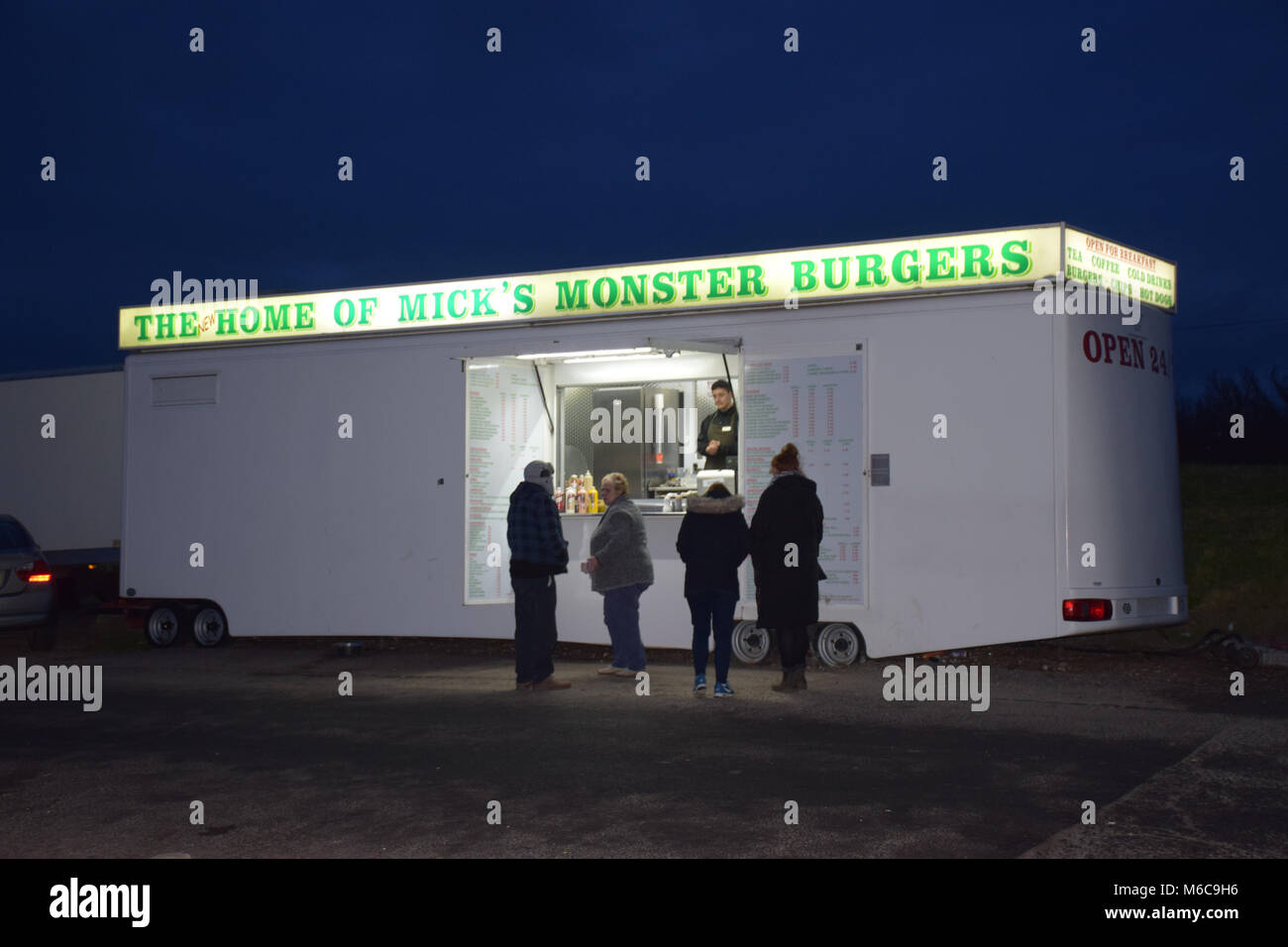 Mobile burger bar at night, Portsmouth UK - Stock Image
