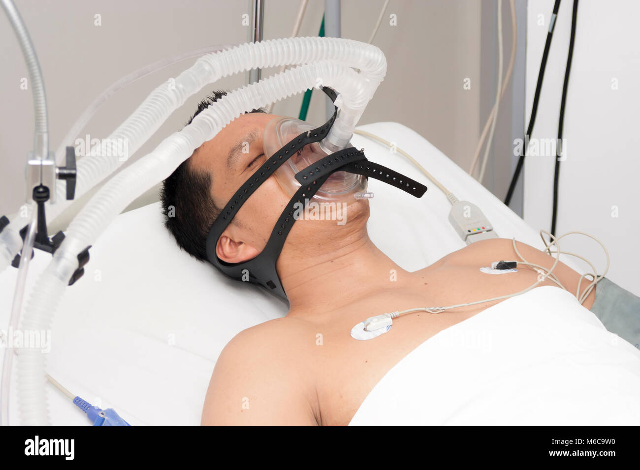 Portrait of patient receives anaesthetic in hospital - Stock Image