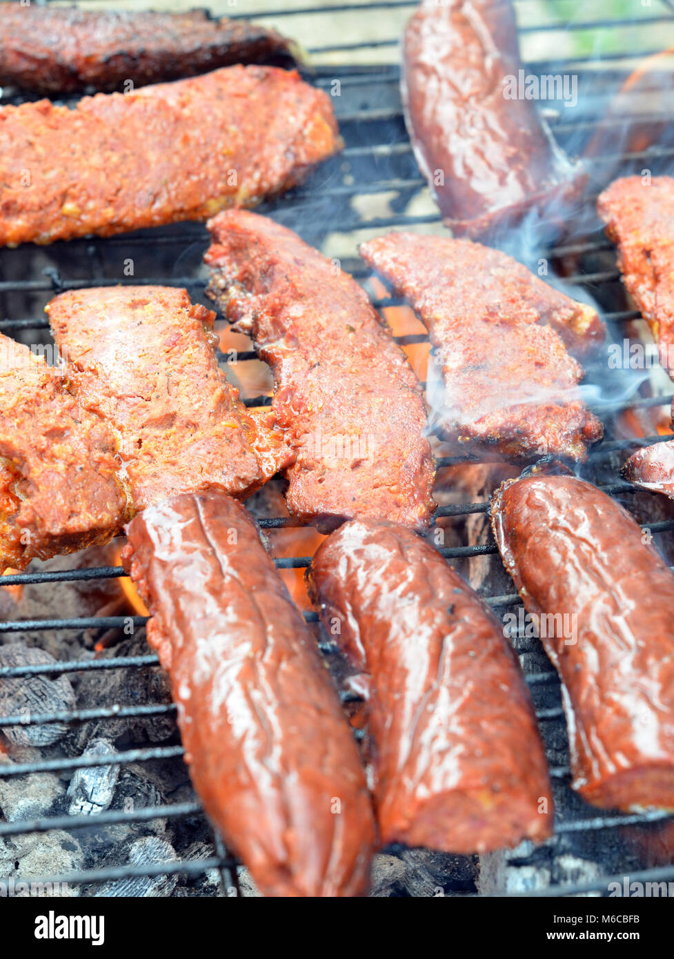Picture of a Fat Sausage on a grill, Food concept - Stock Image