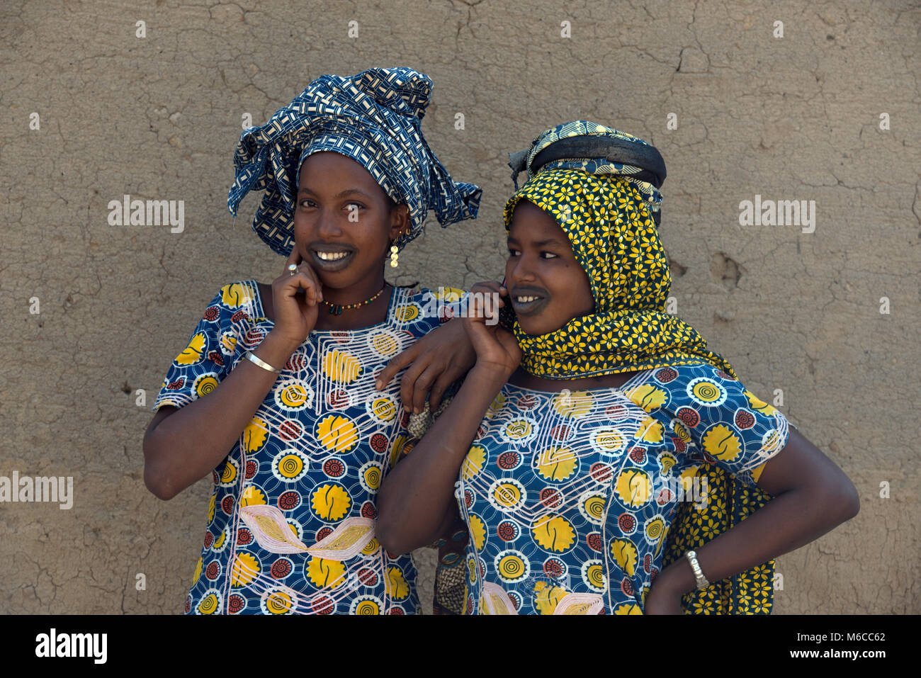 An ethnic, indigenous Fulani woman on her cell, mobile phone. Mali, West Africa. - Stock Image