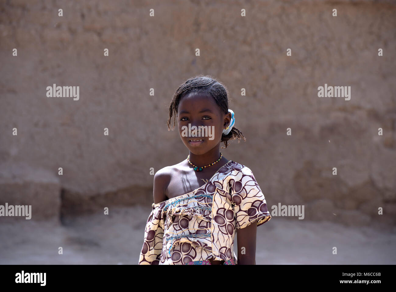 A young, ethnic, indigenous Fulani village girl who has never attended school. Mali, West Africa. - Stock Image