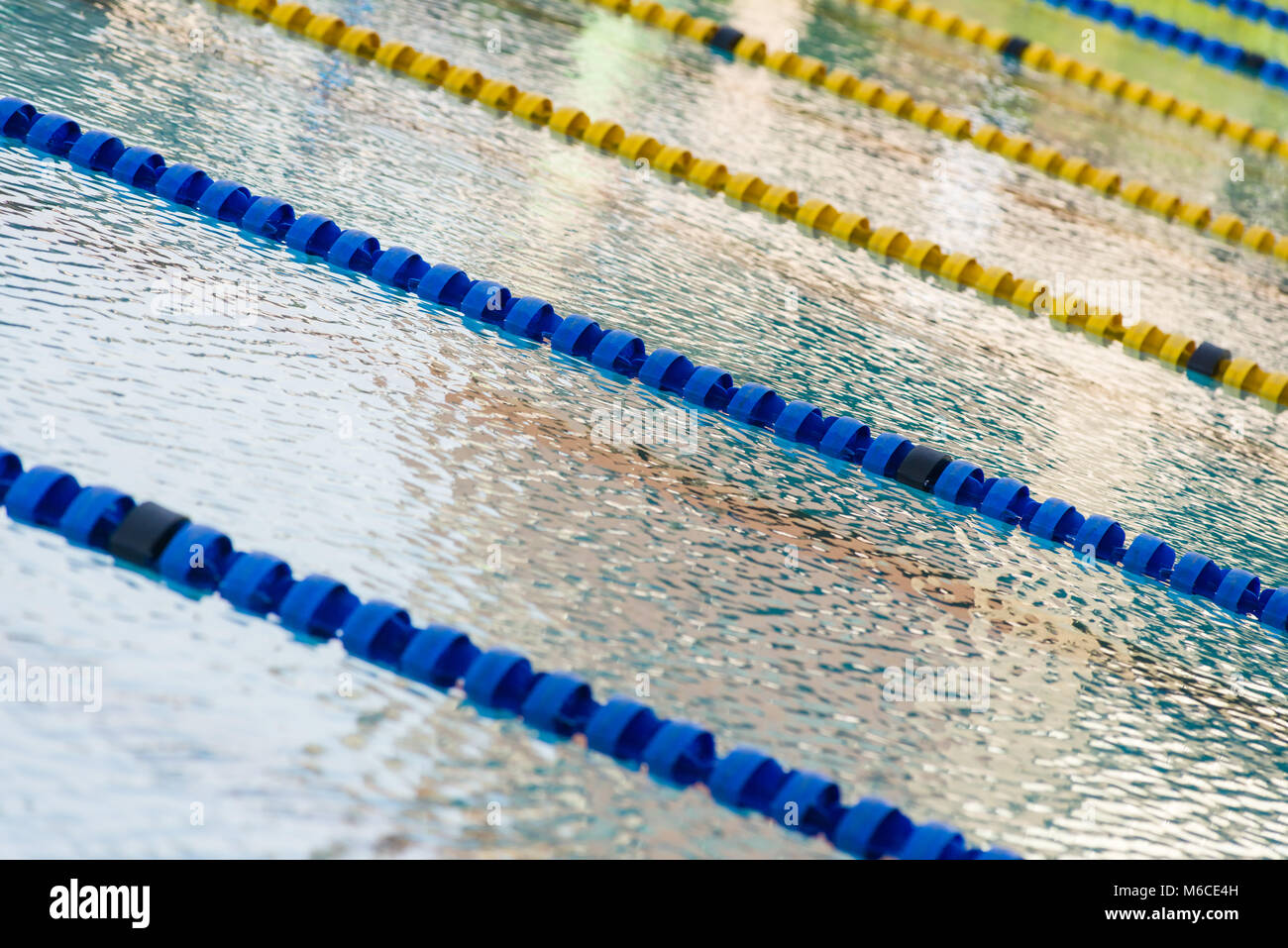 olympic swimming pool lanes. An Empty Outdoor Olympic Swimming Pool With Lanes Divided By Floatation Devices M