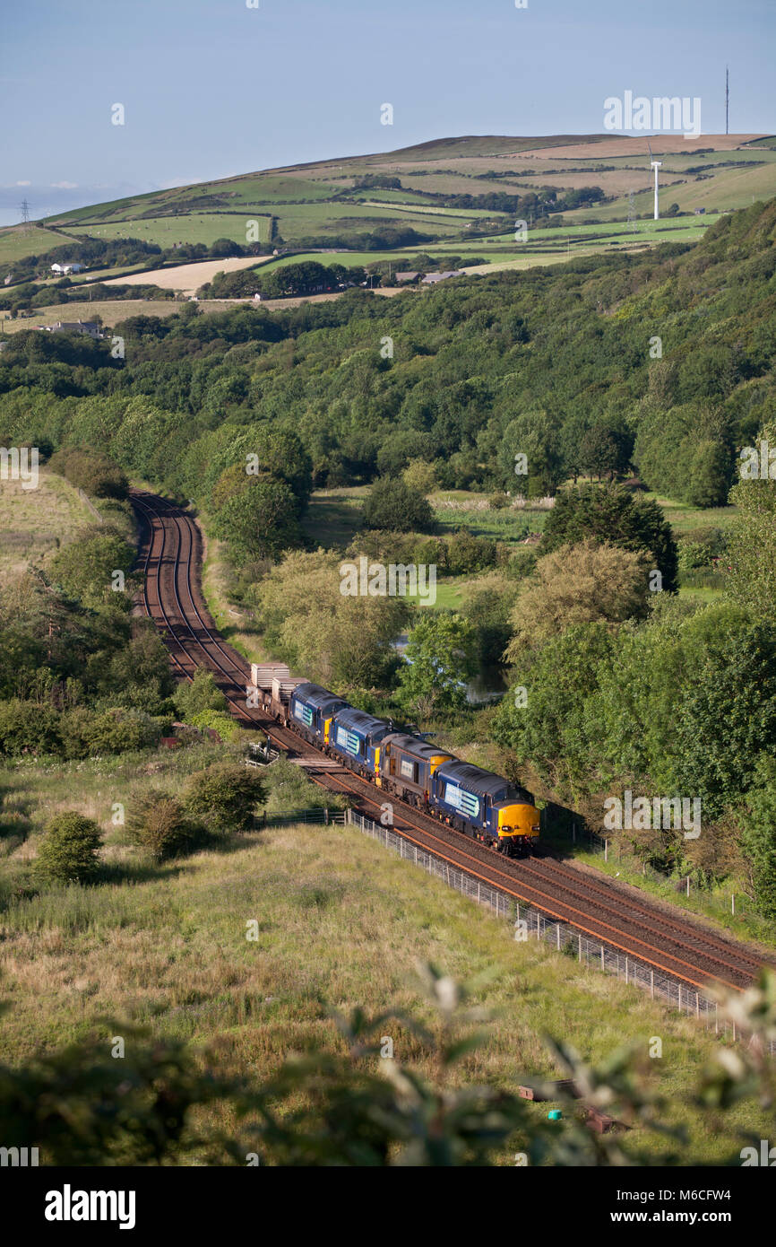A nuclear flask train passes  Park South (north of Barrow In Furness)with 4 direct rail services class 37 and 20 - Stock Image