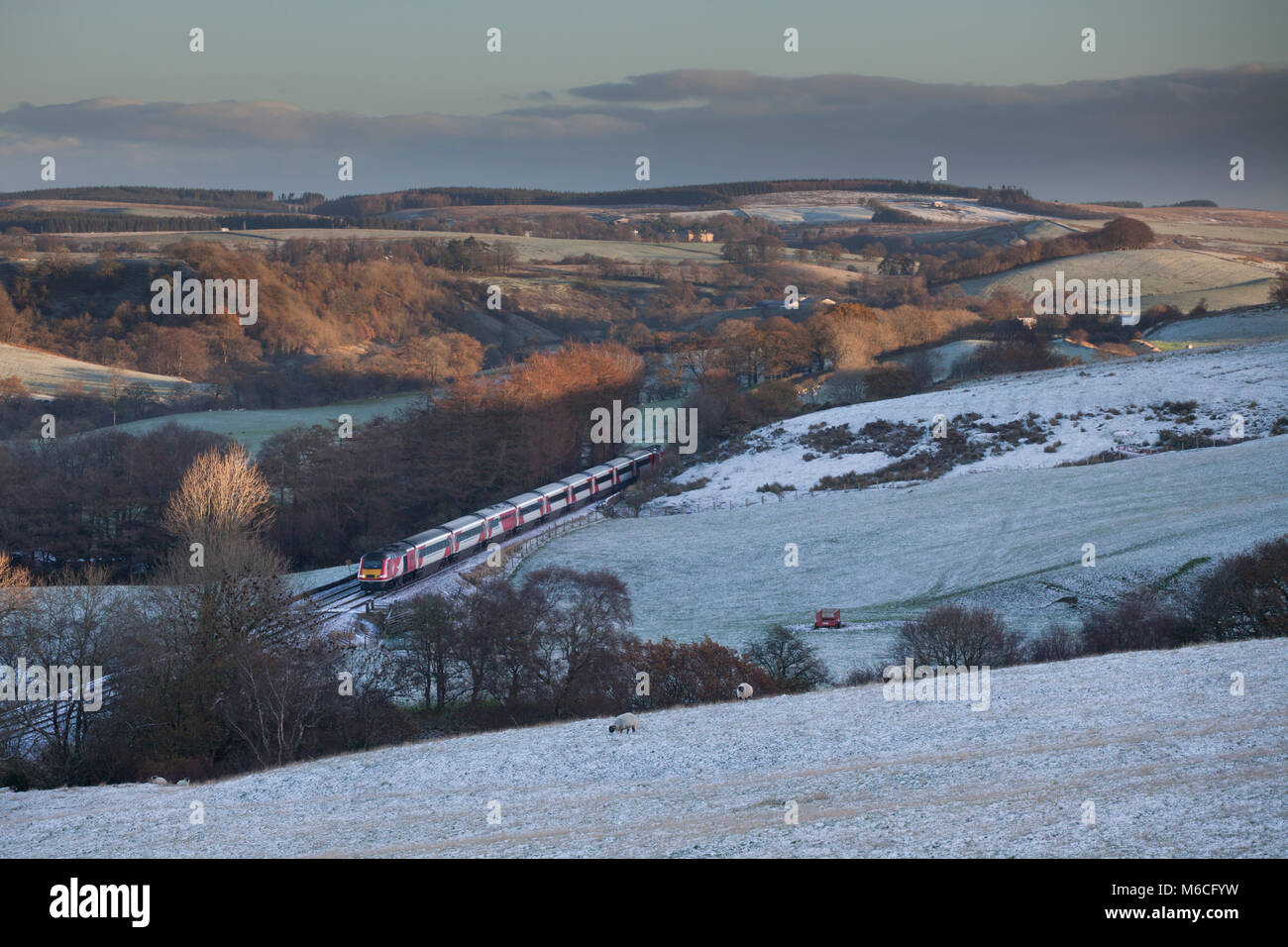 A Virgin trains east coast intercity 125 passes Low Row (east of Brampton, Tyne Valley)  with a train diverted due - Stock Image