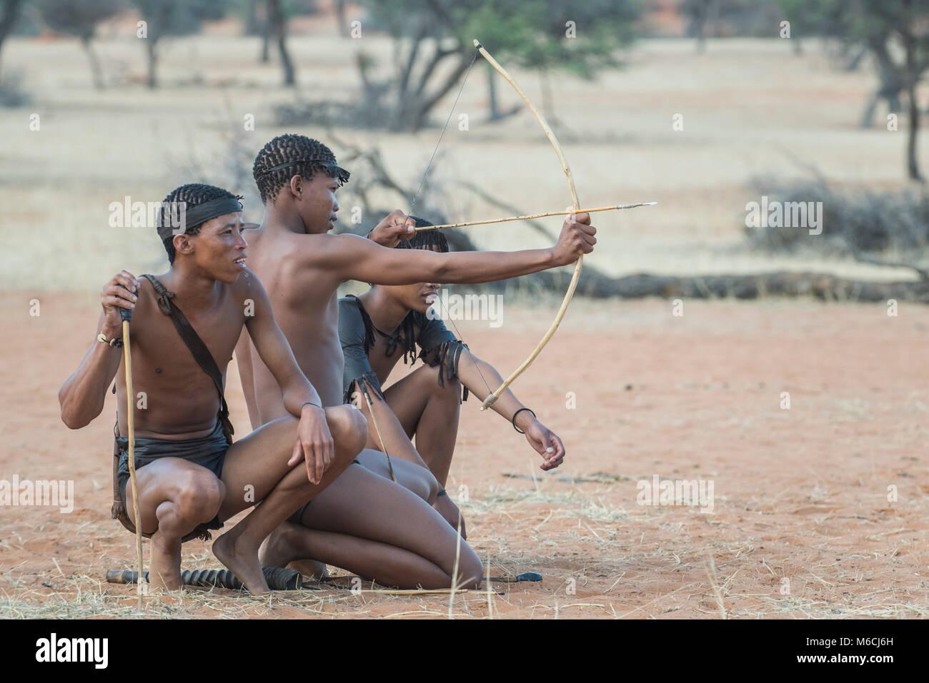 Kung Bushmen with bow and arrow, Zebra Lodge, Hardap Region, Namibia - Stock Image