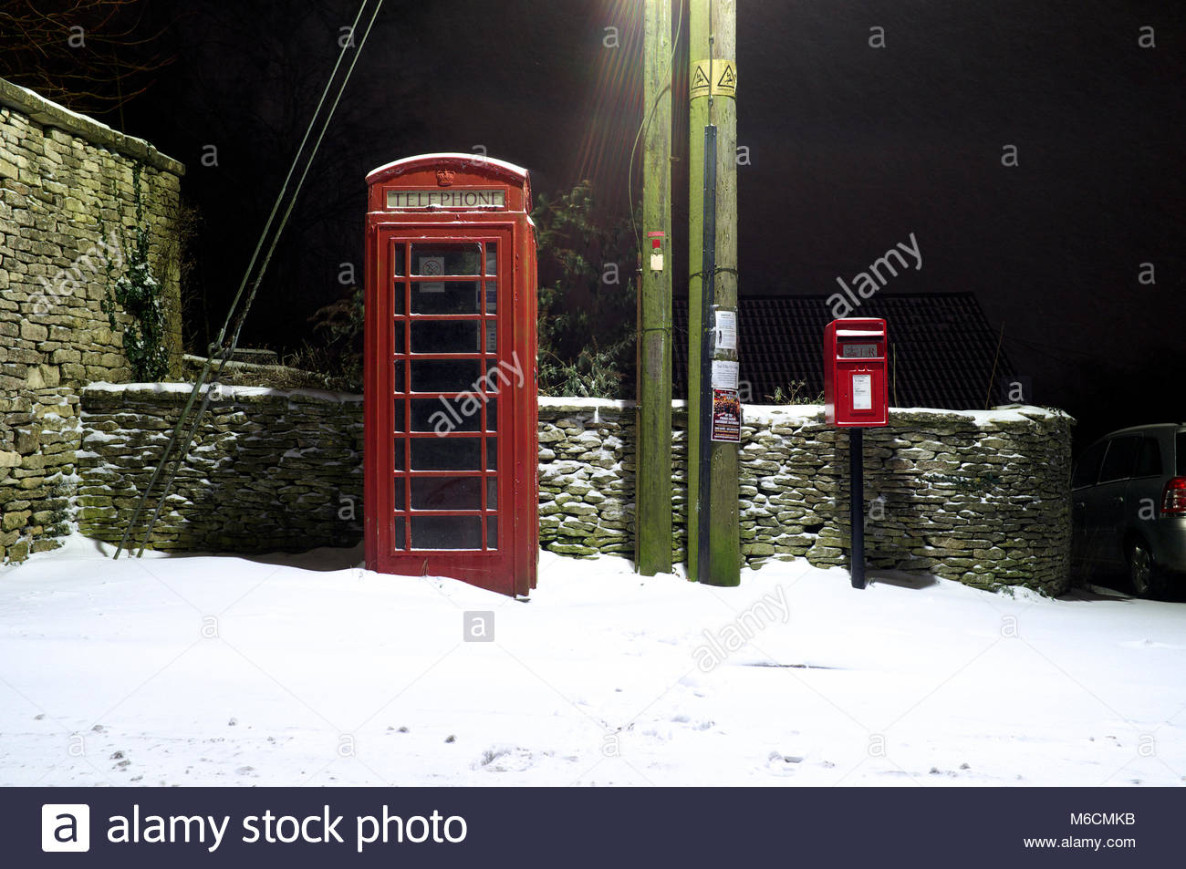 Snow in the Cotwolds, with a K6 telephone box and an adjacent letterbox. On Walkley Hill, Rodborough, Stroud, Gloucestershire, - Stock Image