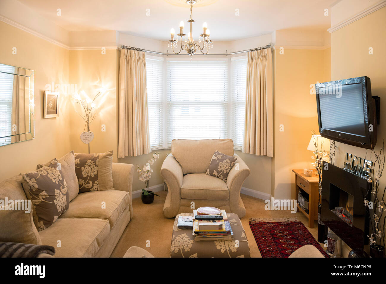 a neutral beige comfortable living room with a bay window ...