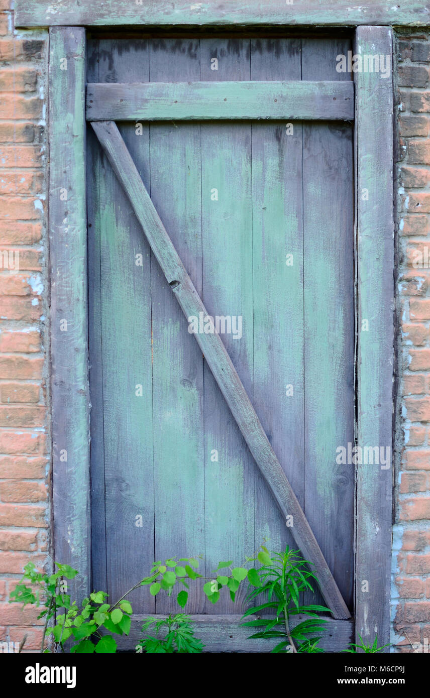 Old door of old house - Stock Image