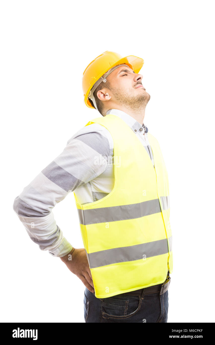 Tired engineer or builder employee suffering lower back lumbar pain isolated on white background - Stock Image