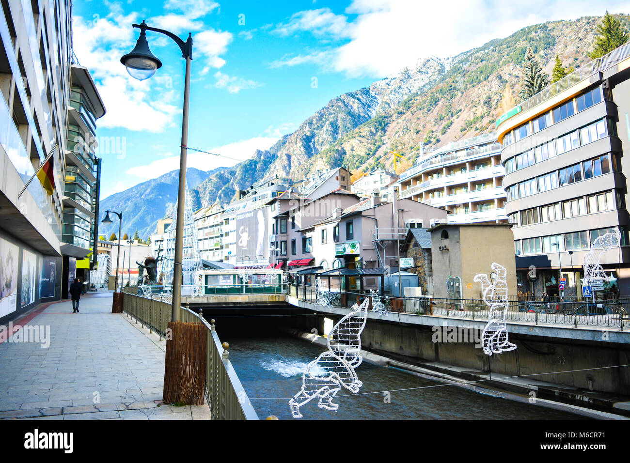 The Gran Valira is the biggest river in Andorra flowing under the Pont de Paris in Andorra la Vella during the winter. Stock Photo