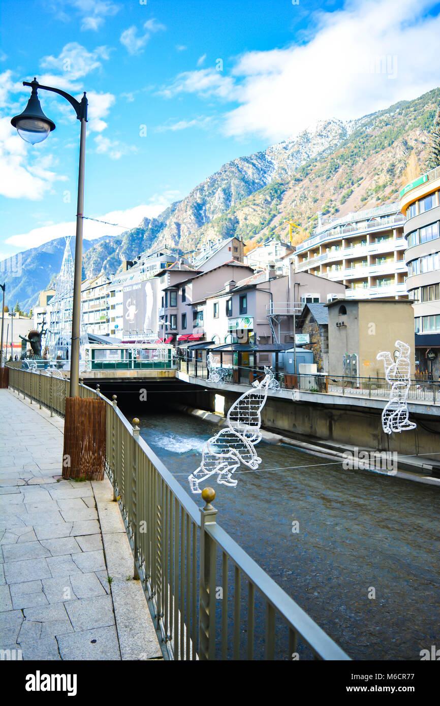 The Gran Valira is the biggest river in Andorra flowing under the Pont de Paris in Andorra la Vella during the winter. - Stock Image