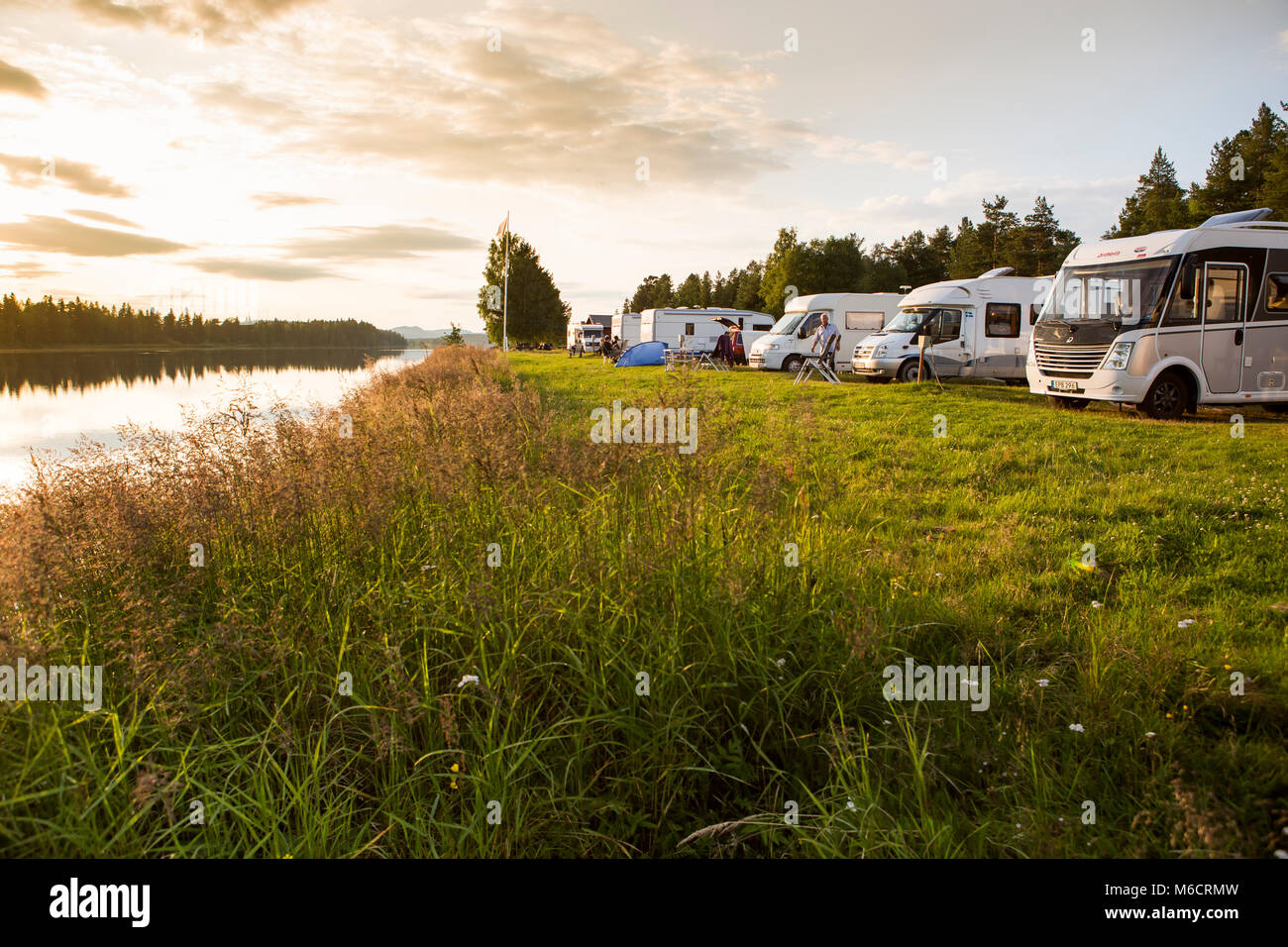 Motorhomes at a Campsite in Sweden, parked with a view over the river. The river is Angermanalven and the campsite - Stock Image