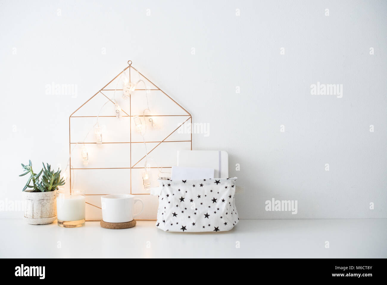 Minimalist Scandinavian Home Decor Storage Box And String Lights In White Room Interior