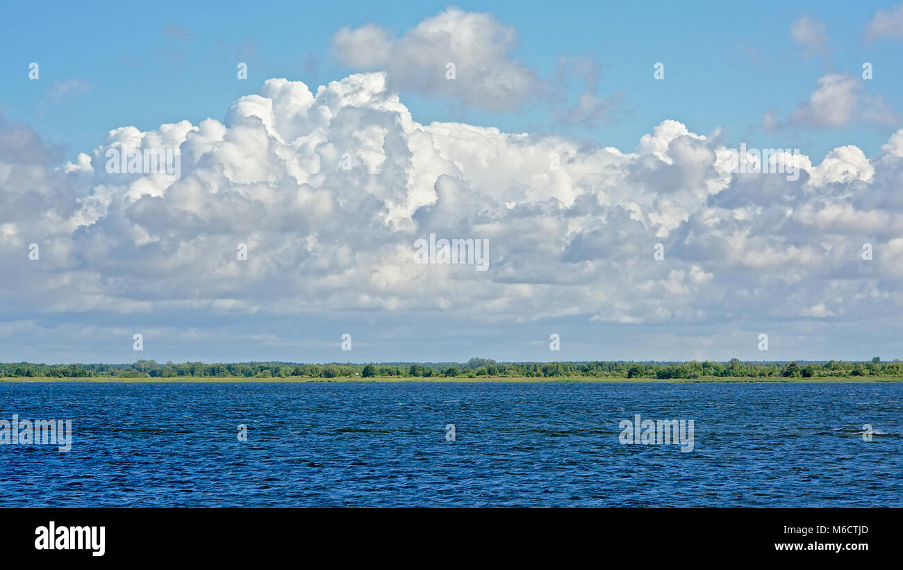 lake of Liepaja, with high clouds above - Stock Image